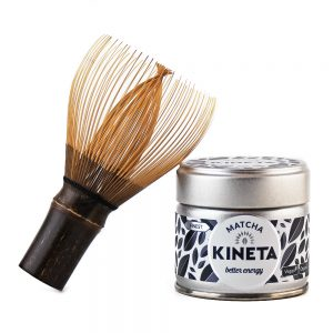Hand-Crafted Japanese Bamboo Chasen Matcha Whisk Resting On A 30g Tin Of Kineta Finest Matcha Tea
