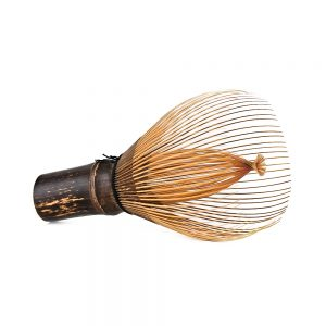 Hand-Crafted Japanese Bamboo Chasen Matcha Whisk Resting On Its Side Zoomed Out