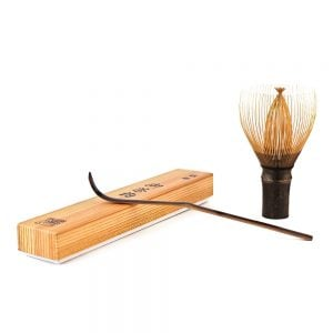 Handcrafted Japanese Bamboo Chasen Matcha Whisk And Chashuku Purple Bamboo Matcha Spoon Resting On Its Box