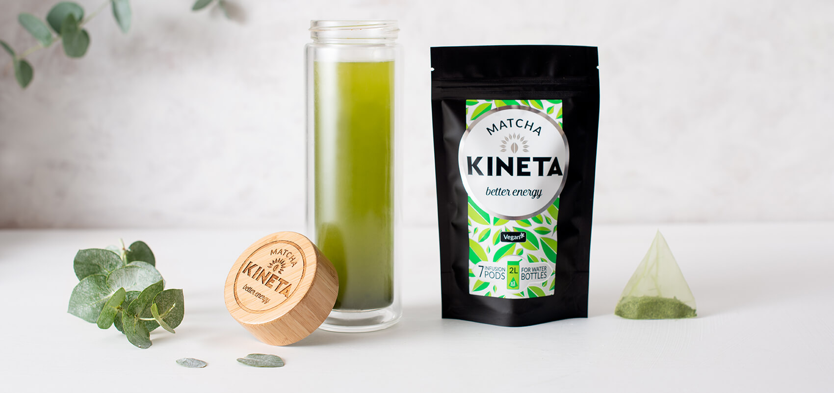 Kineta Matcha Infusion pods next to a cold brew infusion bottle