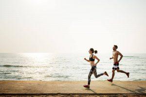 couple-exercising-on-beach